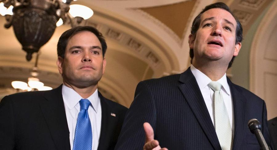 "Sen. Ted Cruz, R-Texas, center, accompanied by Sen. Marco Rubio, R-Fla., left, and Sen. Mike Lee, R-Utah, right, express their frustration after the Senate passed a bill to fund the government, but stripped it of the defund ""Obamacare"" language as crafted by House Republicans, Friday, Sept. 27, 2013, on Capitol Hill in Washington. The Republican-controlled House and the Democrat-controlled Senate are at an impasse as Congress continues to struggle over how to prevent a possible shutdown of the federal government when it runs out of money in three days.  (AP Photo/J. Scott Applewhite)"
